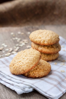 Homemade oatmeal cookies on checkered kitchen towel