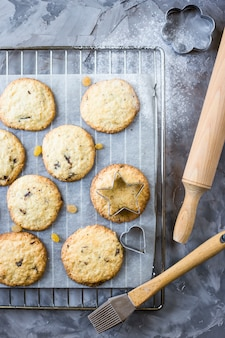 Homemade oatmeal cookies with chocolate chips on a gray kitchen table