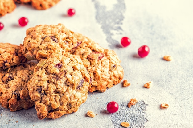 Homemade oatmeal cookies with cranberries, selective focus.