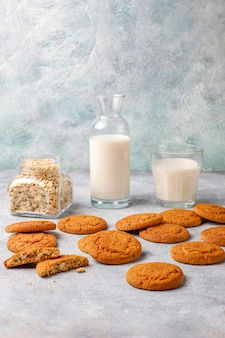 Homemade oatmeal cookies with a cup of milk.