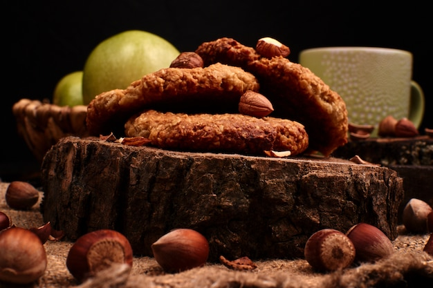 Homemade oatmeal cookies with hazelnuts on wooden background