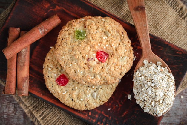 Homemade oatmeal cookies on a wooden table. flat lay