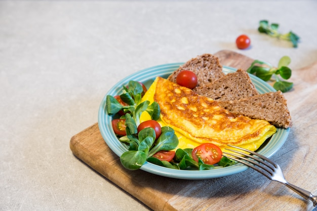 Homemade omelette with salad on plate. healthy food concept