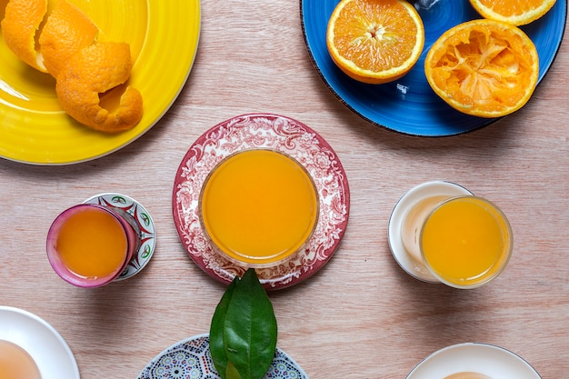 Homemade orange juice from above on wooden table