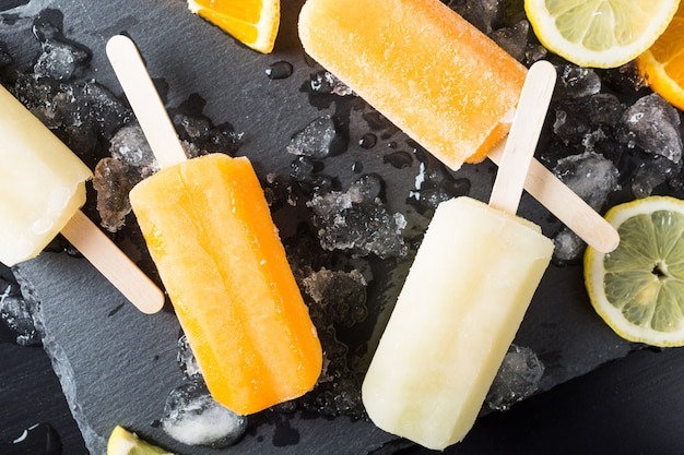 Homemade orange and lemon popsicles