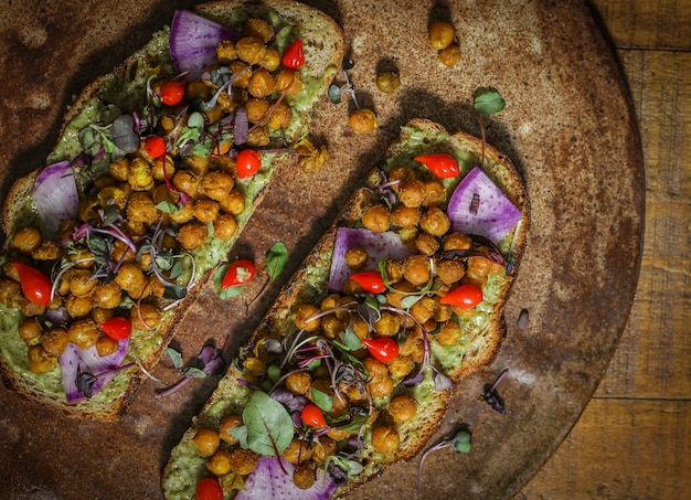 Homemade organic chickpea toast on a wooden plate