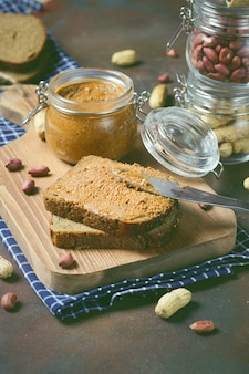 Homemade organic creamy peanut butter in a jar