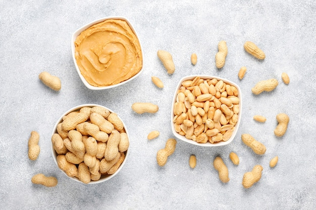 Homemade organic peanut butter with peanuts.