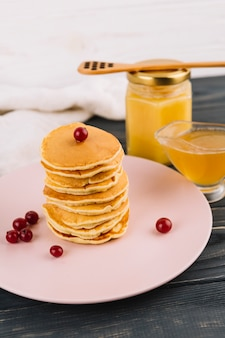 Homemade pancakes with red currant berries and lemon curd bowl