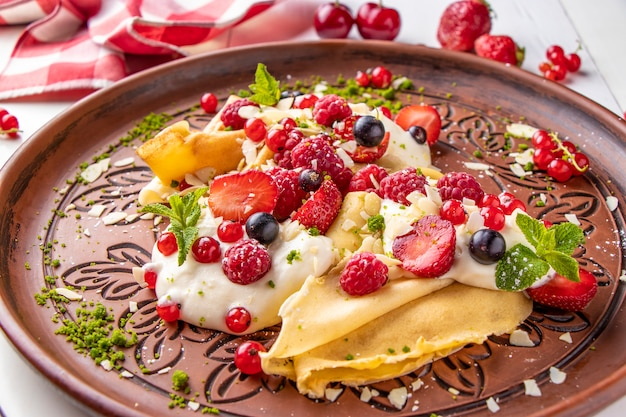 Homemade pancakes with sour cream and berries