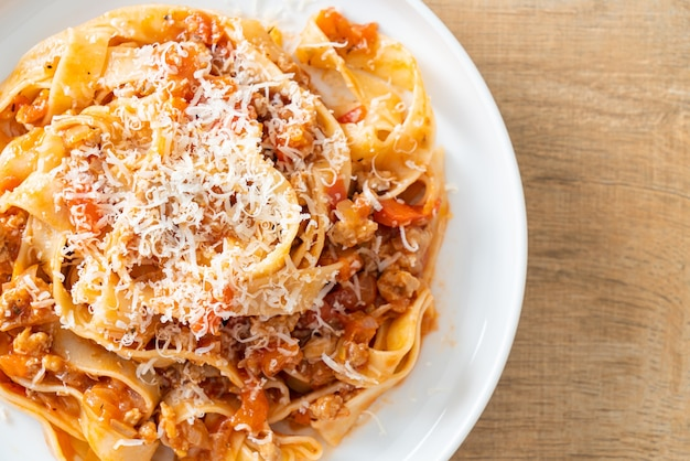 Homemade pasta fettuccine bolognese with cheese - italian food style