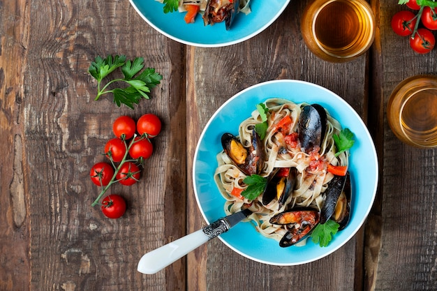 Homemade pasta tagliatelle with mussels in tomato sauce