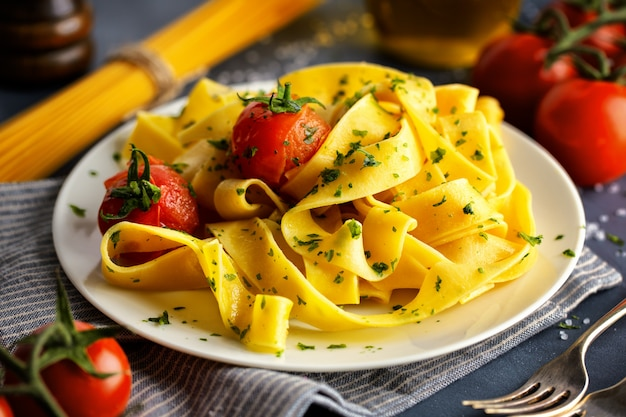 Homemade pasta with herbs and tomatoes
