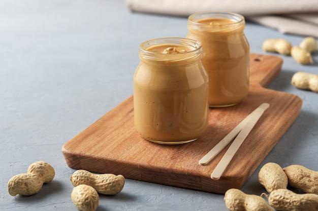 Homemade peanut butter in glass jars