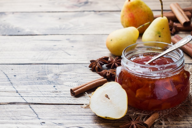 Homemade pear jam in a jar and fresh pears
