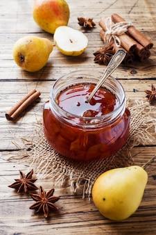 Homemade pear jam in a jar and fresh pears