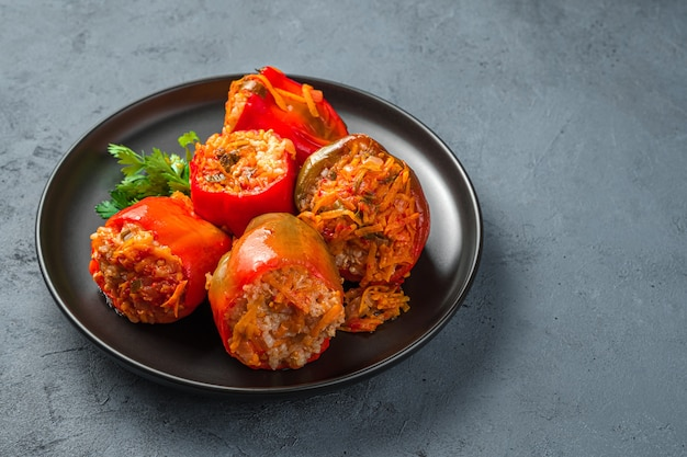 Homemade pepper stuffed with meat and rice on a dark grayblue background