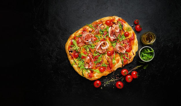 Homemade pepperoni square pizza or pinza with ham, top view, flat lay, copy space