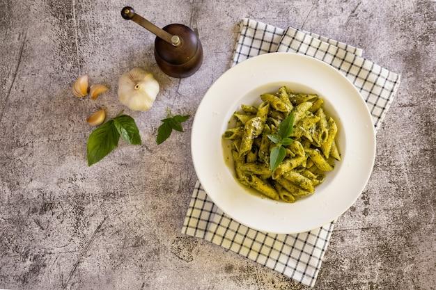 Homemade pesto sauce pasta on the table