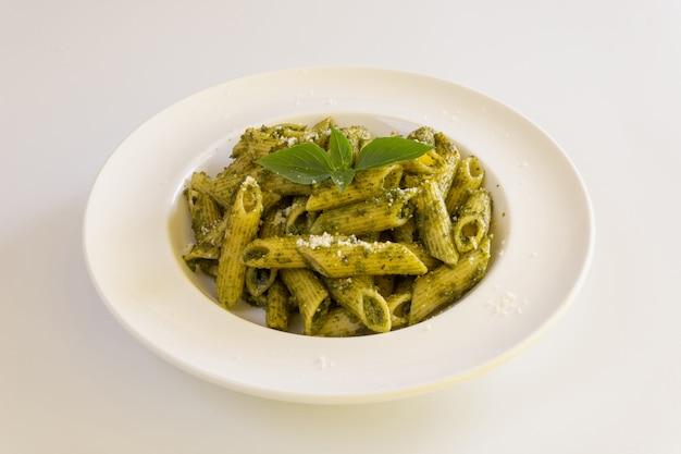 Homemade pesto sauce pasta on white background