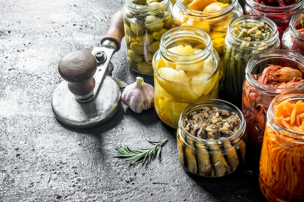 Homemade pickled food. on black rustic table