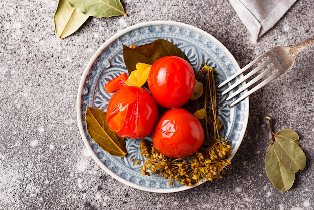 Homemade pickled tomato with spices