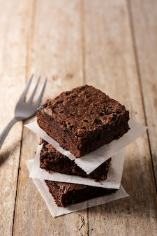 Homemade pieces of brownies on wooden table