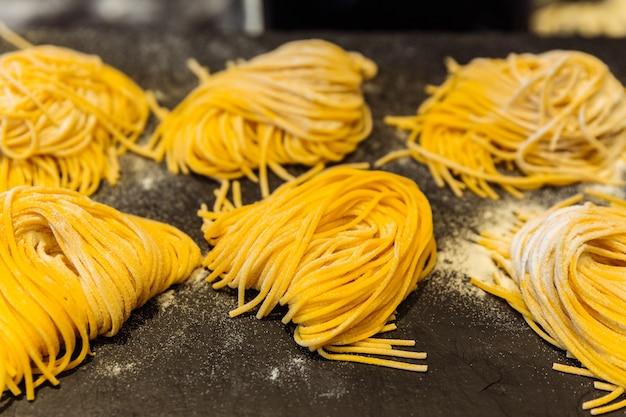 Homemade piles of fresh egg spaghetti pasta