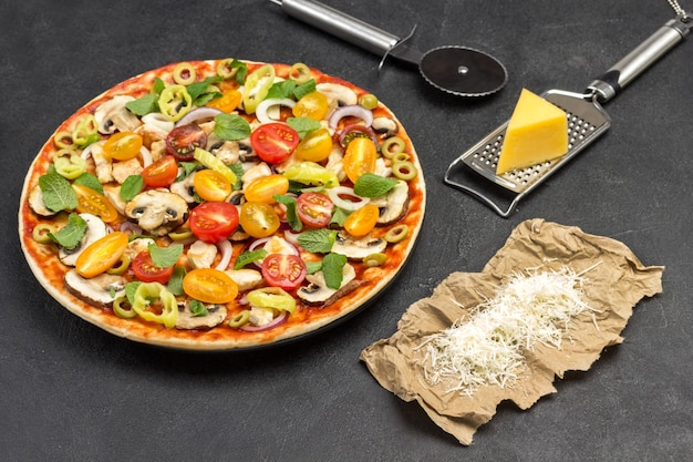 Homemade pizza and various ingredients