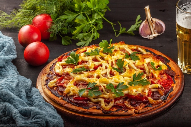 Homemade pizza with meat, sausage, cheese and tomatoes