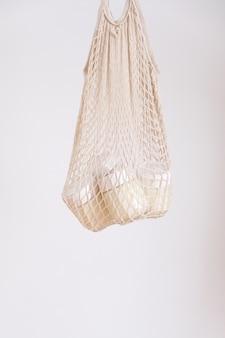 文字列バッグにガラスの瓶にギリシャヨーグルトの自家製鍋