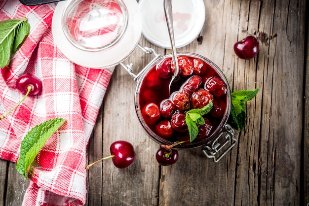 Homemade preserved cherry and mint jam, with fresh cherries