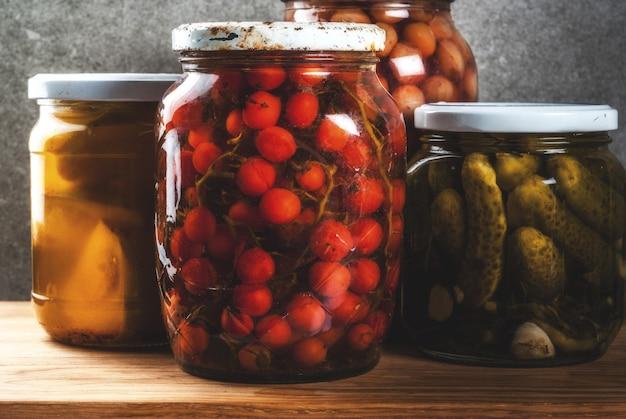 Homemade preserving, canning food, pickled or fermented vegetables in glass jars