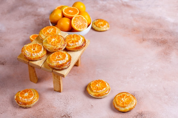 Homemade puff pastry with tangerine slices.