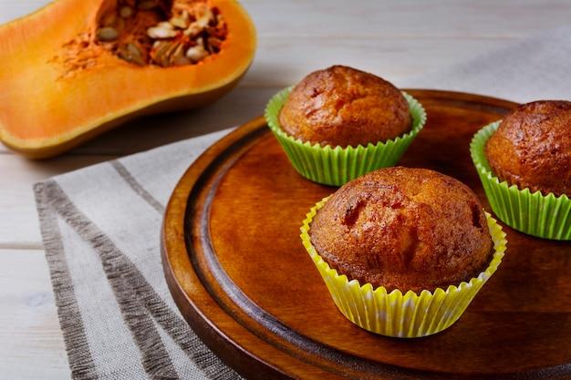 Homemade pumpkin muffins on the cutting board and butternut squash