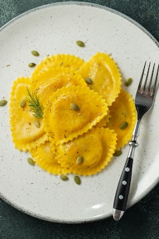 Homemade pumpkin ravioli with butter.