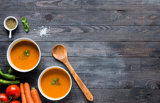 Homemade pumpkin soup on rustic wooden background