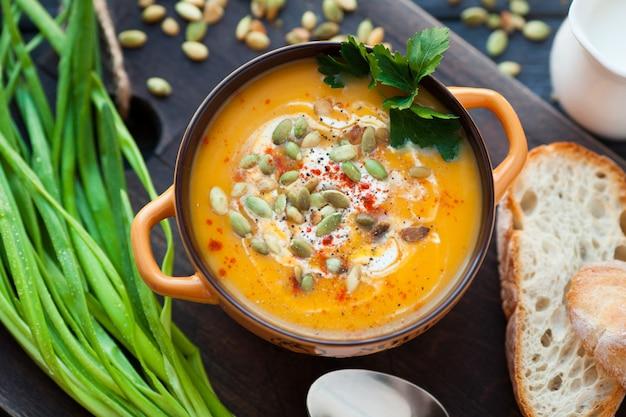 Homemade pumpkin soup with cream.