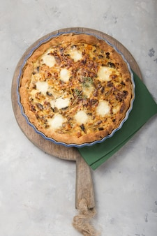 Homemade quiche lorraine with chicken, mushrooms, cheese and bacon.