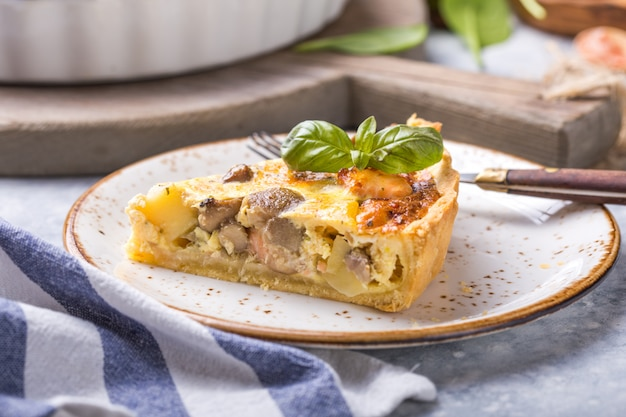 Homemade quiche lorraine with chiken, mushrooms, cheese. . cooking. spices, butter.  tart.