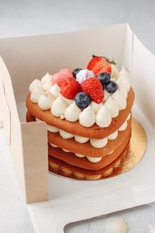 Homemade red velvet cake in heart shape for st. valentine's day