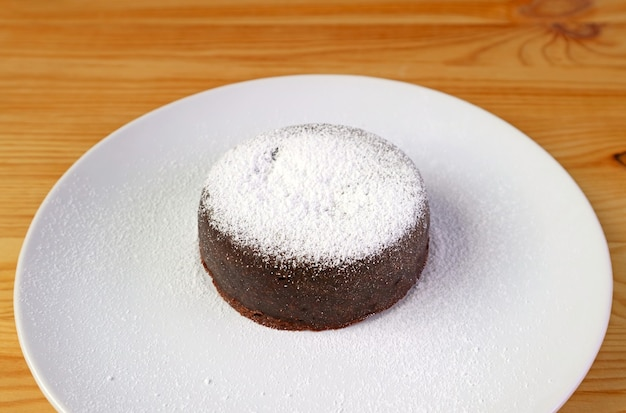 Homemade rich and moist mini chocolate cake sprinkled with icing sugar