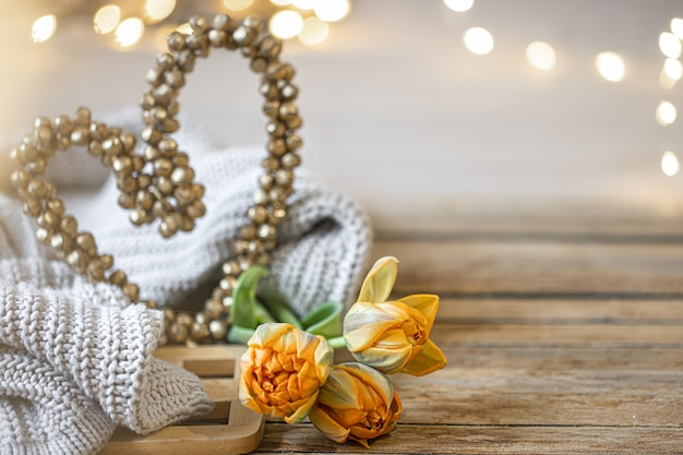 Homemade romantic still life with decorative heart and knitted element on blurred background with bokeh copy space.