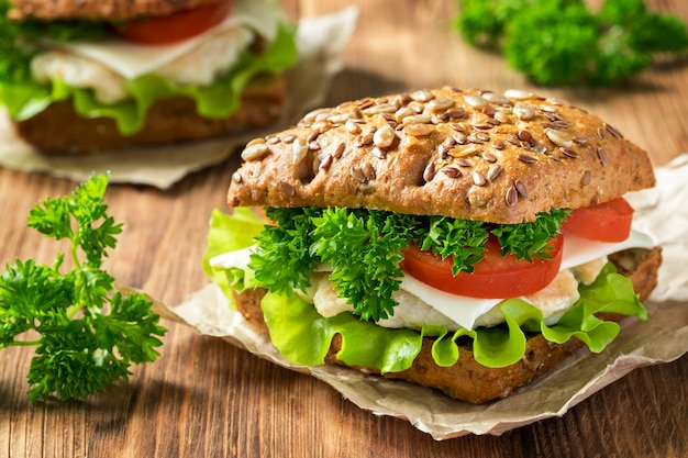 Homemade sandwich with chicken, fresh vegetables and herbs