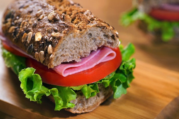 Homemade sandwich with tomatoes salami and salad