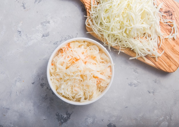 Homemade sauerkraut village fermented cabbage. vegan salad rustic style  organic vegetable  great for good health. traditional russian winter meal. probiotics food concept.