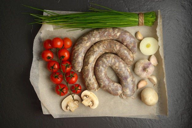 Homemade sausages on a stone surface