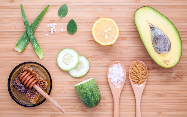 Homemade skin care and body scrub on bamboo cutting board.