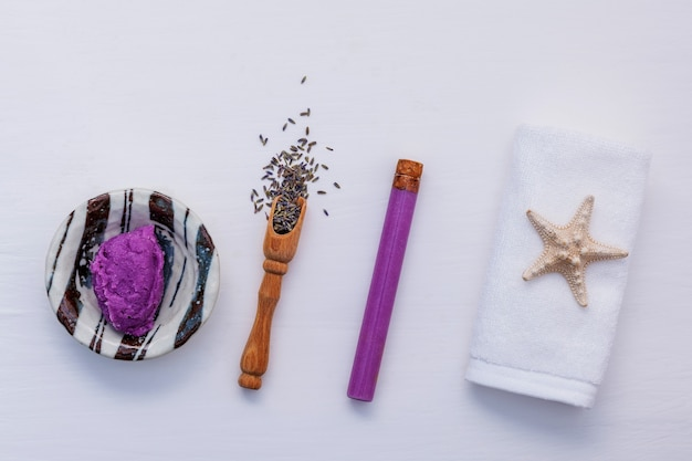 Homemade skin care lavender bath salt beauty treatment on white background flat lay.
