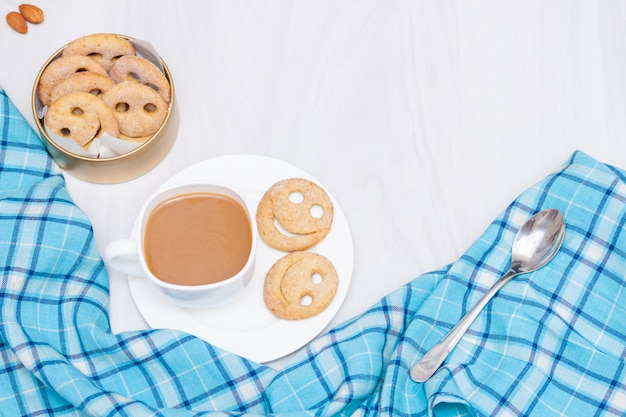 Homemade smile cookies with cup of coffee. good morning or have a nice day concept. flat lay, copy space.